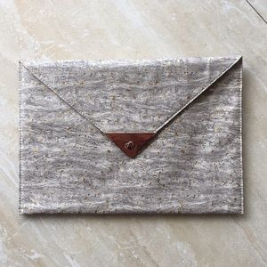 Gray, tan, and gold envelope clutch